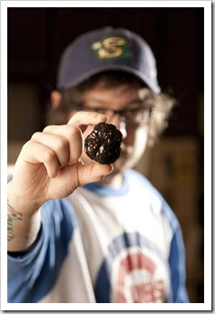 Tobiah holds up a black truffle