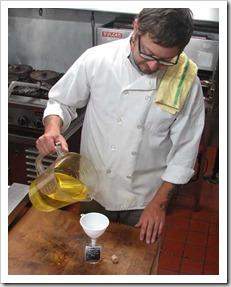 Tobiah pouring truffle oil